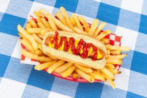 hot dog on tablecloth