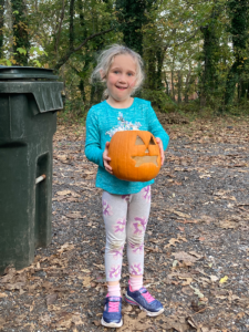 little girl & pumpkin