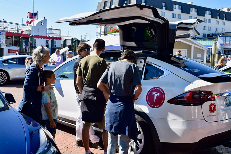 People check out Electric Vehicles, including this Tesla Model X at Annapolis NDEW Kick Gas EV Showcase Sept 2021