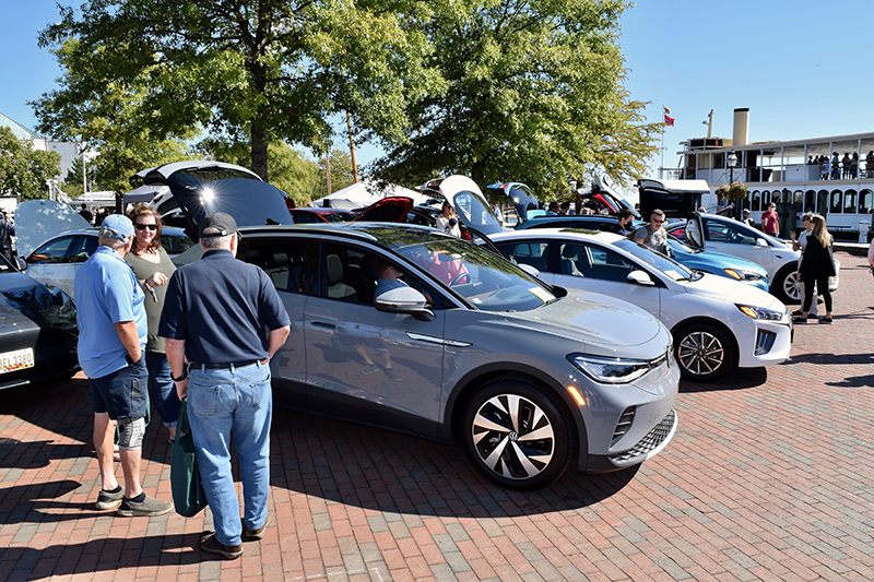 People check out many EV models including this VW ID.4 at Annapolis NDEW Kick Gas EV Showcase Sept 2021